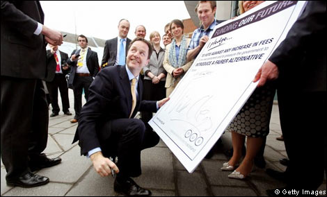 Nick Clegg signing the NUS anti-tuition fees pledge.