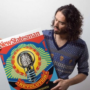 Russell Brand holds aloft the cover to his issue of the New Statesman