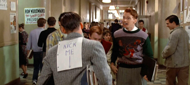"George McFly from Back to the Future, with a ""kick me"" sign on his back."